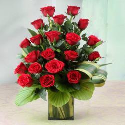 Ravishing Twenty Red Roses in Glass Vase for Kanchipuram