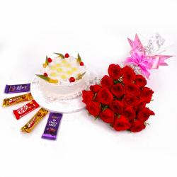 Red Roses and Pineapple Cake with Cadbury Chocolates for Imphal