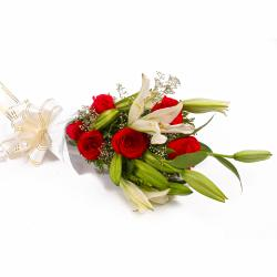 Red Roses with White Lilies in Tissue Wrapping for Lucknow