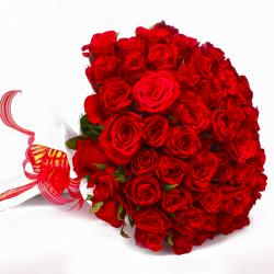 Romantic Gift of 50 Red Roses Tissue Wrapped for Dombivli