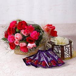 Roses and Carnations with Chocolate Cake and Cadbury Bars for Gurgaon