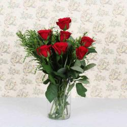 Seven Roses in a Glass Vase for Bhopal