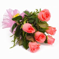 Six Pink Roses with Tissue Wrapping for Moga