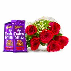 Six Red Roses Bouquet with Bars of Cadbury Fruit and Nuts Chocolate for Gurgaon