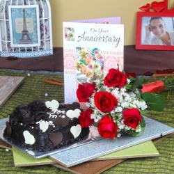 Six Red Roses Hand Tied Bunch and Heart Shape Chocolate Cake with Anniversary Greeting Card for Kolkata