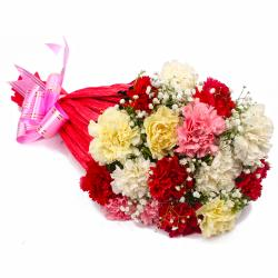 Sixteen Multi Color Carnations Tissue Wrapped for Gurgaon