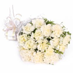 Sixteen White Carnations Cellophane Wrapped for Ghaziabad