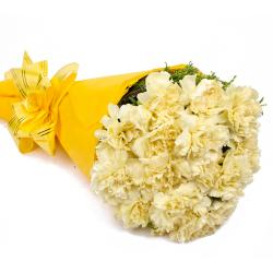 Sixteen Yellow Carnations Tissue Wrapped for Gurgaon