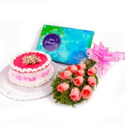 Strawberry Cake with Cadbury Celebration and Pink Roses Bunch for Dewas