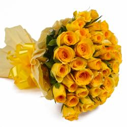 Thirty Five Yellow Roses in Tissue Paper Packing for Raichur