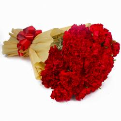 Thirty Red Carnations in Tissue Wrapping for Chennai