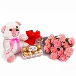 Twelve Pink Carnations and 16 Pcs Ferrero Rocher with Teddy Bear for Noida