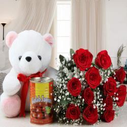 Twelve Roses Bouquet and Teddy Bear with Tasty Gulab Jamuns for Kolkata