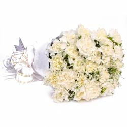 Twenty White Carnations with Tissue Wrapping for Bharuch